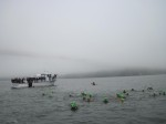 Exiting the boat and swimming to the start line.